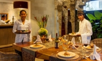 Dining Table with Food and Staff - Abaca Villas - Seminyak, Bali