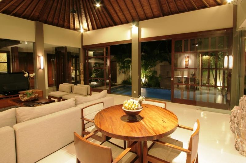 Living Area with Pool View at Night - Akara Villas 1 - Seminyak, Bali