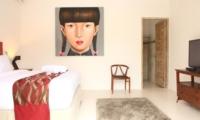 Bedroom with Painting and TV - Briana Villa - Batubelig, Bali