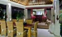Living and Dining Area with Mirror at Night - Chandra Villas - Seminyak, Bali