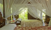Twin Bedroom with Mosquito Net - Isle East Indies - Thousand Islands, Indonesia