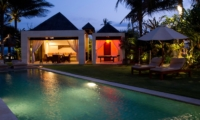 Reclining Sun Loungers at Night - Majapahit Beach Villas - Sanur, Bali