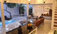 Living Area with Pool View at Night - Santai Villa - Batubelig, Bali