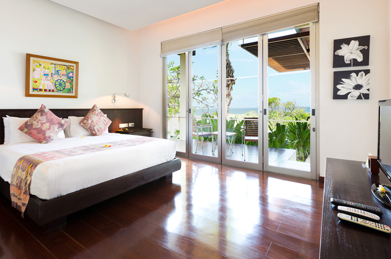 Bedroom with TV and Wooden Floor - Sanur Residence - Sanur, Bali
