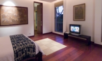Bedroom with Wooden Floor and TV - Sanur Residence - Sanur, Bali