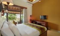 Bedroom with TV - The Kumpi Villas - Seminyak, Bali