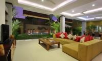 Living Area with Pool View at Night - The Kumpi Villas - Seminyak, Bali