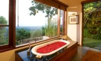 Romantic Bathtub Set Up - The Longhouse - Jimbaran, Bali