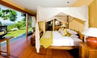 Bedroom with TV - The Longhouse - Jimbaran, Bali