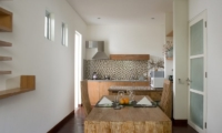 Kitchen and Dining Area with Wooden Floor - The Seiryu Villas - Seminyak, Bali