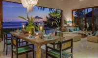 Living and Dining Area with Sea View at Night - Tirta Nila - Candidasa, Bali