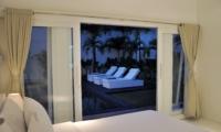 Bedroom with Pool View at Night - Villa Arta - Seminyak, Bali