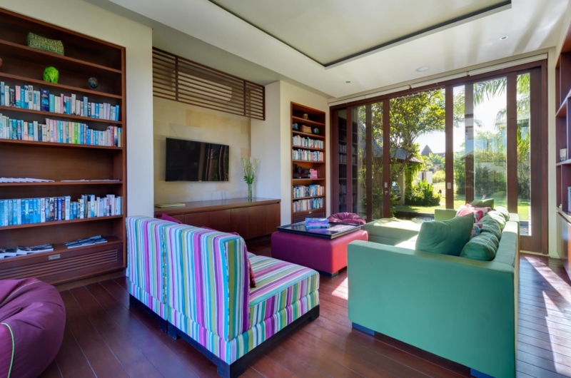 Lounge Area with TV and Book Shelves - Villa Bendega Nui - Canggu, Bali