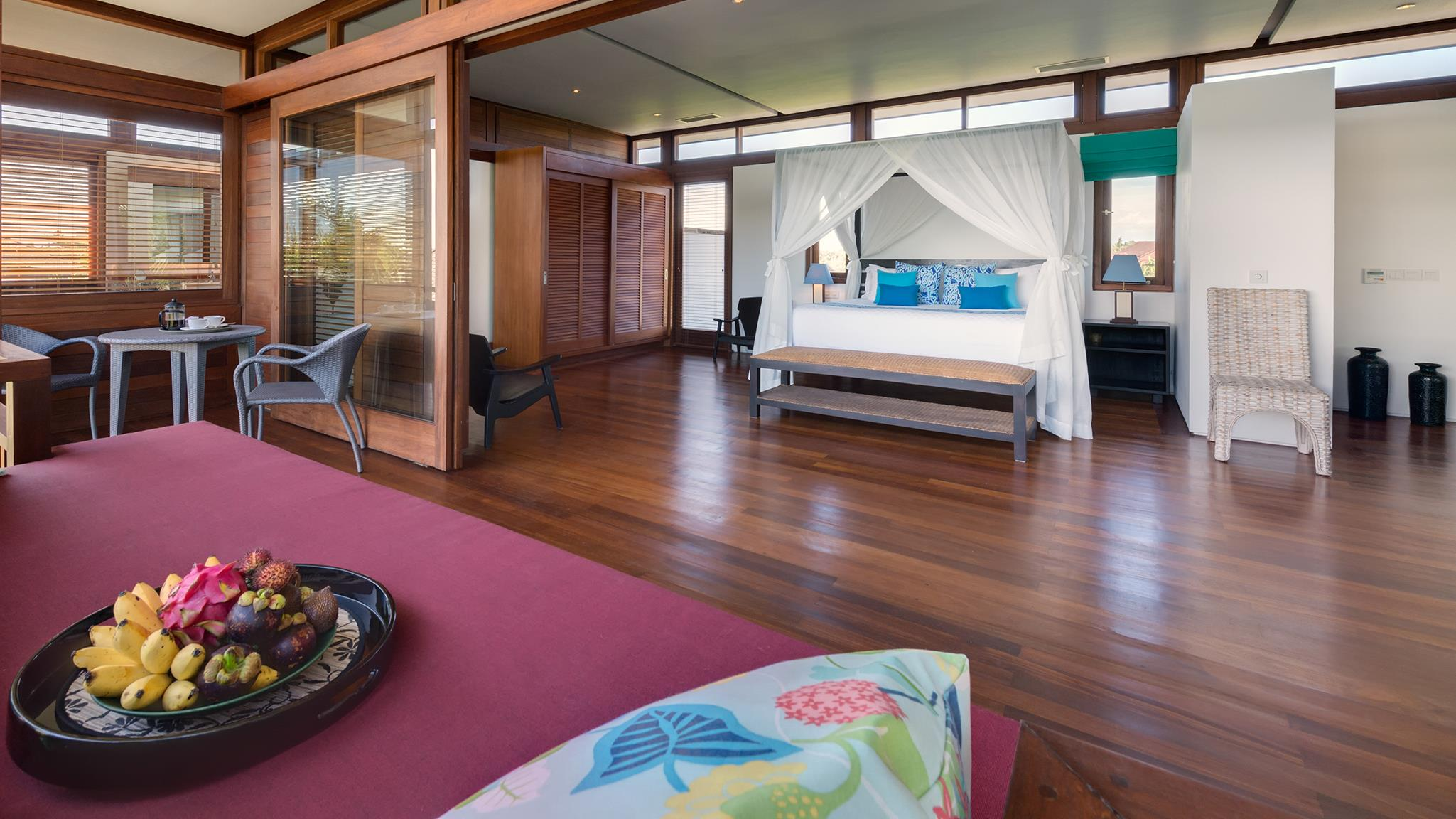 Spacious Bedroom with Wooden Floor and Fruits - Villa Bendega Rato - Canggu, Bali