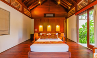 Bedroom with Wooden Floor and Side Lamps - Villa Champuhan - Seseh, Bali