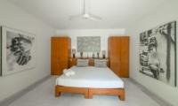 Bedroom with Wardrobes and Paintings - Villa Chocolat - Seminyak, Bali