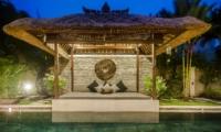Pool Side Seating Area at Night - Villa Damai - Seminyak, Bali