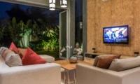 Living Area with TV at Night - Villa Damai Aramanis - Seminyak, Bali