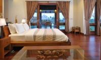 Bedroom with Wooden Floor - Villa Griya Atma - Ubud, Bali