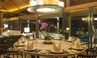 Dining Area with Pool View at Night - Villa Hamsa - Ungasan, Bali