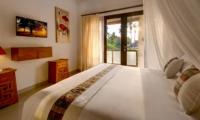 Bedroom with TV - Villa Istana Dua - Seminyak, Bali