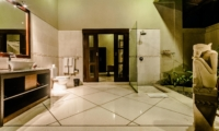 En-Suite Bathroom at Night - Villa Kebun - Seminyak, Bali