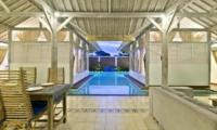 Pool Side Living and Dining Area at Night - Villa Laksmana 2 - Seminyak, Bali