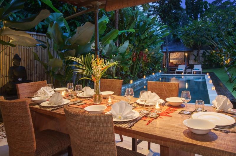 Dining Table with Pool View at Night - Villa Liang - Batubelig, Bali