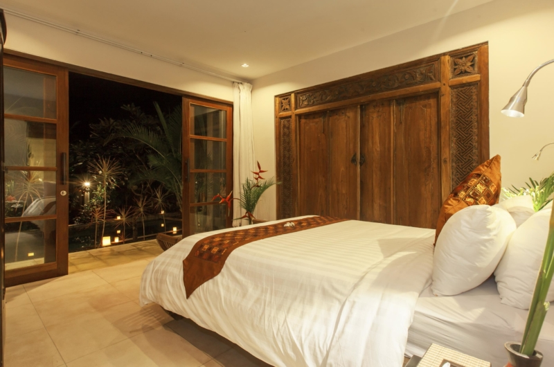 Bedroom with Pool View at Night - Villa Liang - Batubelig, Bali