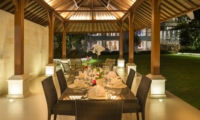 Dining Area with Garden View at Night - Villa Markisa - Ungasan, Bali