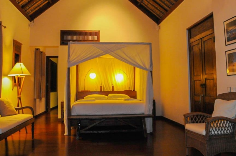 Bedroom with Mosquito Net at Night - Villa Pantai Lima Estate - Canggu, Bali