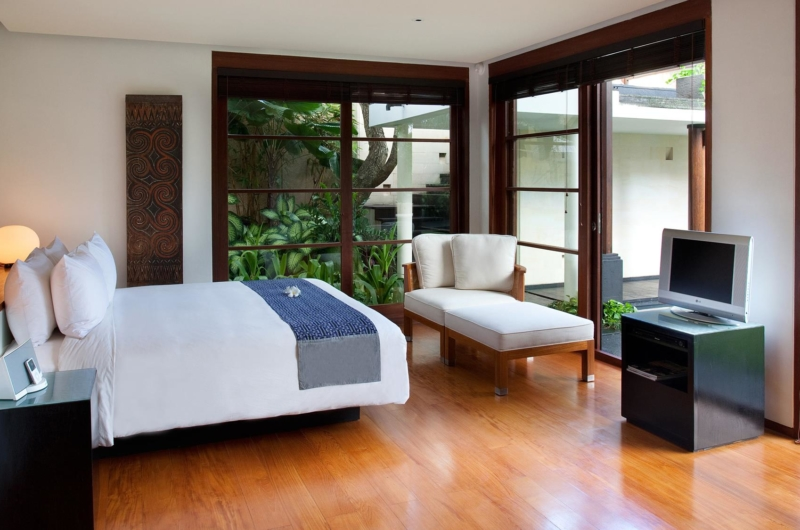 Bedroom with Wooden Floor and TV - Villa Ramadewa - Seminyak, Bali