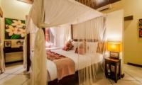 Bedroom with Mosquito Net and Table Lamps - Villa Santai - Seminyak, Bali