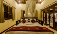 Bedroom with Pool View at Night - Villa Santi - Seminyak, Bali
