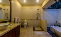 Semi Open Bathroom with Bathtub at Night - Villa Santi - Seminyak, Bali