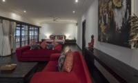 Bedroom with Sofa and Wooden Floor - Villa Tjitrap - Seminyak, Bali