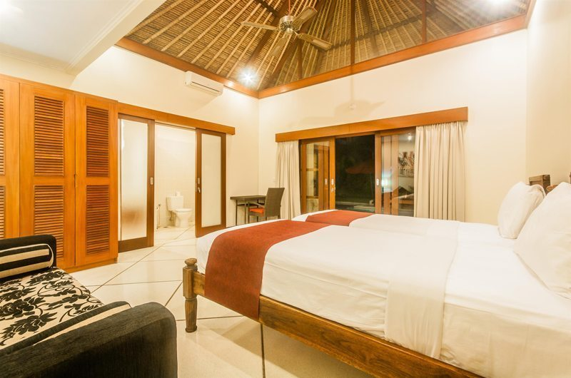 Twin Bedroom with Sofa at Night - Villa Vara - Seminyak, Bali