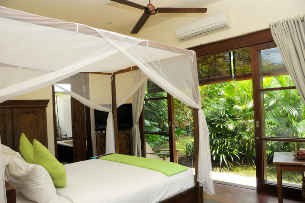Bedroom with Wooden Floor and View - Villa Waringin - Pererenan, Bali