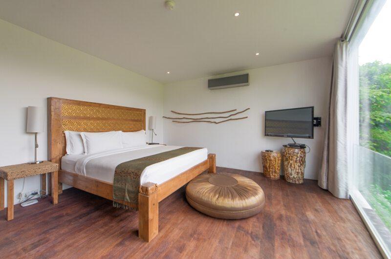 Bedroom with Wooden Floor and TV - Villa Ashoka - Canggu, Bali