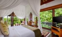 Bedroom with Mosquito Net and TV - Villa Kubu Bidadari - Canggu, Bali