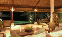Living Area with Pool View at Night - Villa Ria Sayan - Ubud, Bali