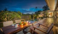 Pool Side Dining at Night - Villa Roemah Natamar - Canggu, Bali