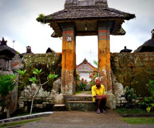 Man In Front Of Entrance Penglipuran