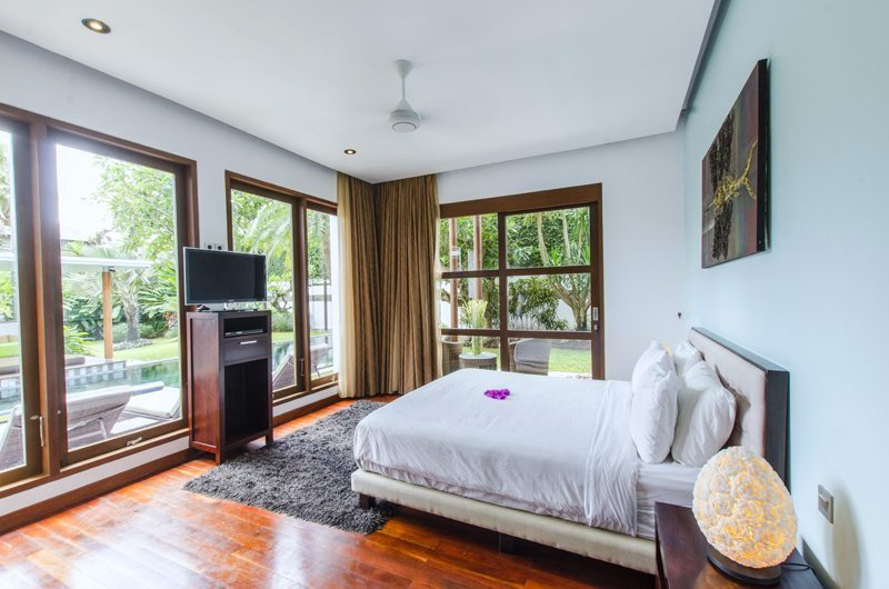 Bedroom with Wooden Floor and TV - Mary's Beach Villa - Canggu, Bali