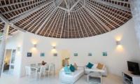 Living and Dining Area with TV - Sunset Palms Resort - Gili Trawangan, Lombok